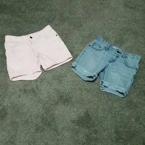 Two pairs of girls jean shorts.